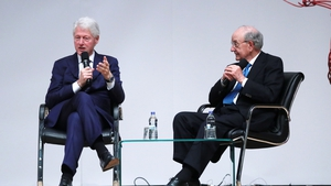 Bill Clinton and George Mitchell speaking in Belfast