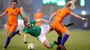 Katie McCabe is fouled by Stephanie van der Gragt