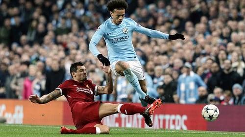Manchester City's Leroy Sane is tackled by Liverpool's Dejan Lovren