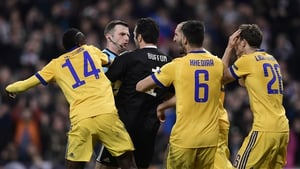 Juventus players surround referee Michael Oliver after the late, late penalty that sealed their fate