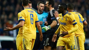 Gianluigi Buffon confronts referee Michael Oliver