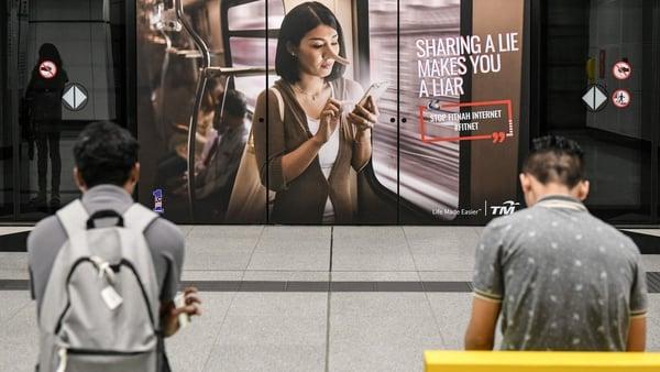 An anti-fake news advert from Telekom Malaysia in downtown Kuala Lumpur. Photo: Mohd Rasfan AFP/Getty Images