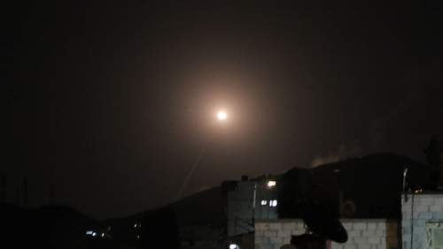 A missile from the Syrian Arab Air Force attempts to intercept a coalition missile in the skies above Damascus