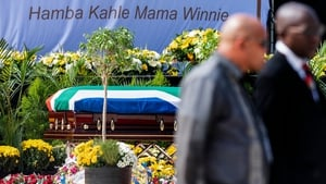 Mourners sang and cheered as her body was brought into the Orlando stadium where the funeral service was taking place