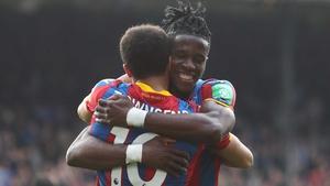 An elated Wilf Zaha celebrates after Crystal Palace's crucial win