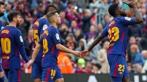 Samuel Umtiti (R) celebrates his goal