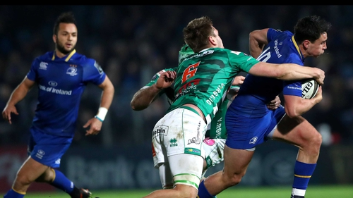 Benetton's Marco Fuser and Federico Ruzza tackle Joey Carbery of Leinster