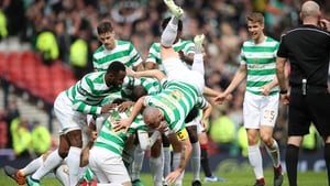 Celtic players celebrating one of their two goals against city rivals Rangers.