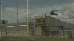 A British army helicopter lands at a base right beside Crossmaglen Rangers' pitch in Armagh
