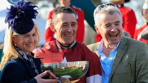 Michael O'Leary (R) and his wife Anita celebrate winning the Grand National with jockey Davy Russell