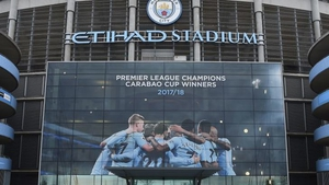 A poster at the Etihad Stadium celebrating City's title triumph