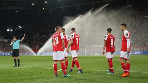 The sprinklers were on at half-time as the players were ordered back onto the pitch