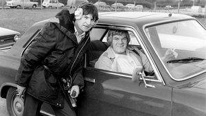 Big Tom (right) with RTÉ floor manager Tom Flanagan, in the town of Castleblayney, County Monaghan, during the filming of RTÉ Television's 'Donncha's Travelling Roadshow' in March 1980.