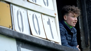 The scoreboard operator watches on during the Munster MFC Playoff semi-final between Limerick and Tipp in Newcastle West