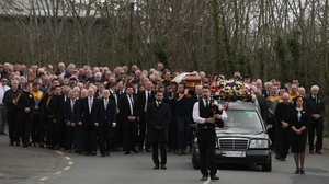 The cortege is seen making its way towards St Patrick's Church