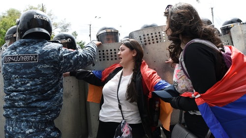 Armenian police scuffle with opposition supporters during a rally in Yerevan today