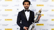 Liverpool's Mohamed Salah poses with the PFA Player Of The Year Award Trophy