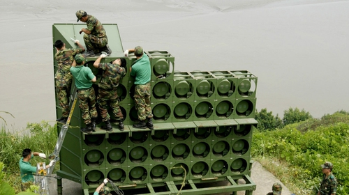 South Korea soldiers dismantle loudspeakers from an observatory near the with North Korea