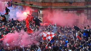 Liverpool fans greet Manchester City's team bus ahead of the Champions League quarter-final first leg at Anfield
