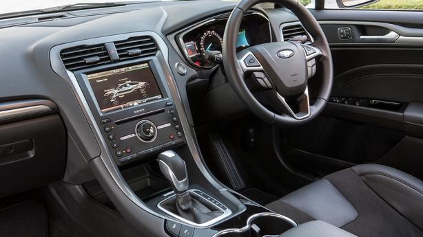 A dashboard feature encourages gradual braking for energy regeneration
