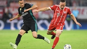 Franck Ribery (R) challenges Real Madrid's Spanish midfielder Lucas Vazquez
