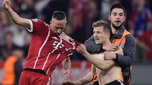 Frank Ribery was confronted by pitch invader