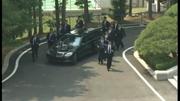 Web video: Bodyguards jog along Kim Jong-un's car