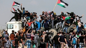 Palestinian protesters gathered at five sites near the Gaza-Israeli border fence today
