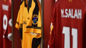 Dunboyne jerseys placed beside Liverpool jerseys in the Anfield dressing room