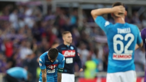 Napoli players dejected at full-time