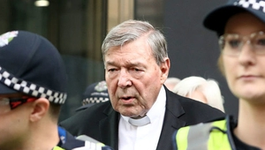 Cardinal Pell leaving court after the prosecution and defence agreed to press for two separate trials