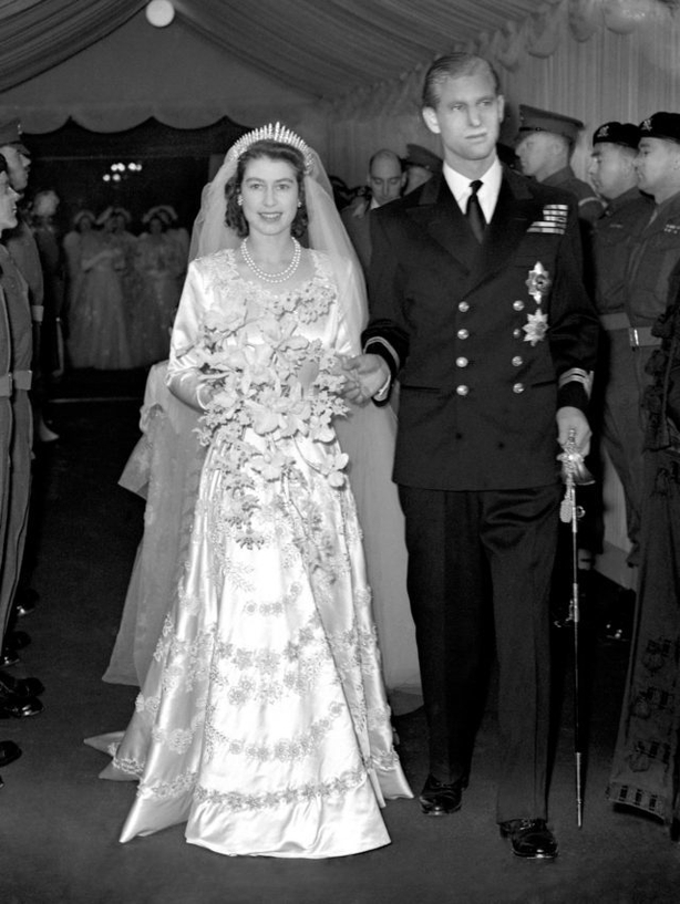 Queen Elizabeth II and Prince Philip leaving Westminster Abbey (PA)