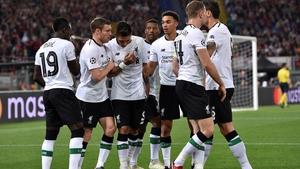 Liverpool players celebrate Sadio Mane's opening goal against Roma
