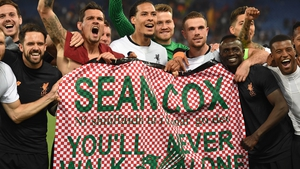Liverpool players display a banner in honour of Sean Cox after reaching the Champions League final