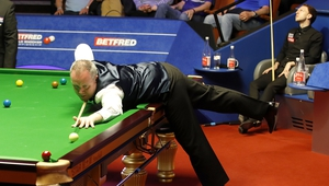 Judd Trump can't look as Higgins sinks another ball