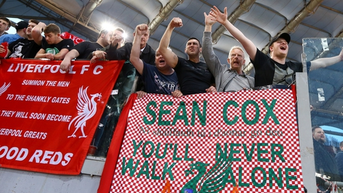 Liverpool fans hang a banner in support of Meathman Sean Cox in Rome