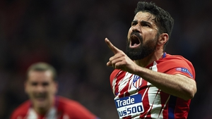 Diego Costa celebrates his second-half goal against Arsenal