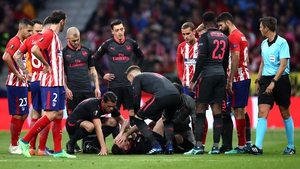 Laurent Koscielny may miss World Cup after being stretchered off with a suspected Achilles injury