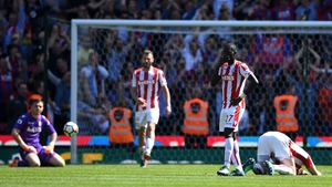 Stoke players despondent as their relegation from the Premier League is confirmed