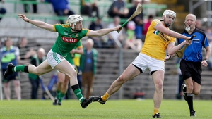 Antrim's Conor Carson scores a point despite Damien Healy's attentions