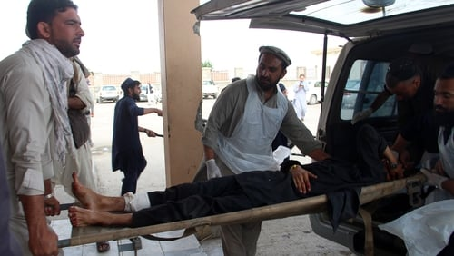 A wounded man is rushed to hospital following the blast in Khost province