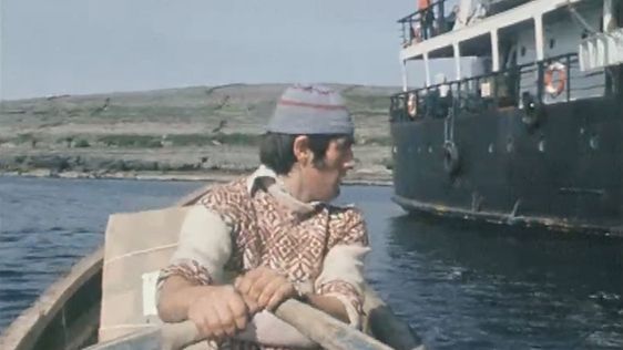 Man rowing currach from Inis Meáin to the Naomh Éanna ferry (1978)