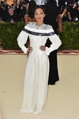 Ruth Negga wore a white Vuitton gown to the 2018 Met Gala. Theme: Heavenly Bodies: Fashion and the Catholic Imagination.