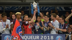 PSG captain Thiago Silva (R) and Les Herbiers skipper Sebastien Flochon raise the trophy