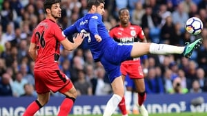 Christopher Schindler of Huddersfield Town looks on as Alvaro Morata of Chelsea shoots