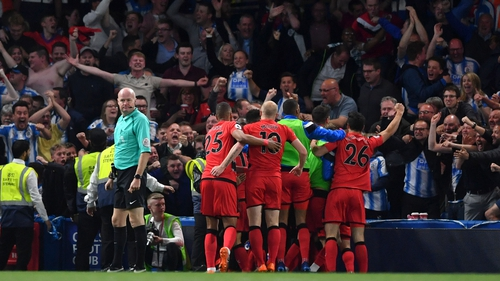 The Terriers celebrate the goal that should keep them in the top flight