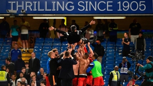 Huddersfield Town's German head coach David Wagner is thrown in the air by his players and staff