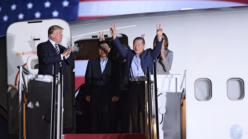 US President Donald Trump applauds as US detainee Kim Dong-chul gestures upon his return with Kim Hak-song and Tony Kim