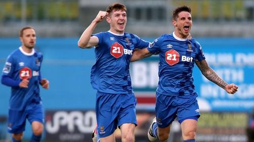 Rory Feely celebrates with Waterford goal-scorer Gavan Holohan