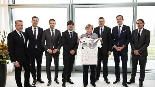 Coach Joachim Löw and some of the German squad pictured with Angela Merkel